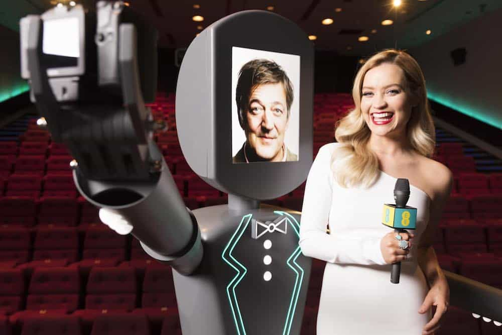 Laura Whitmore trials the EE Roboselfie with BAFTA host Stephen Fry ahead of the EE British Academy Film Awards 2017. Film fans can be in with a chance of getting a selfie with a film star from the red carpet on Sunday 12 February by tweeting a picture to #EEBAFTAselfie.